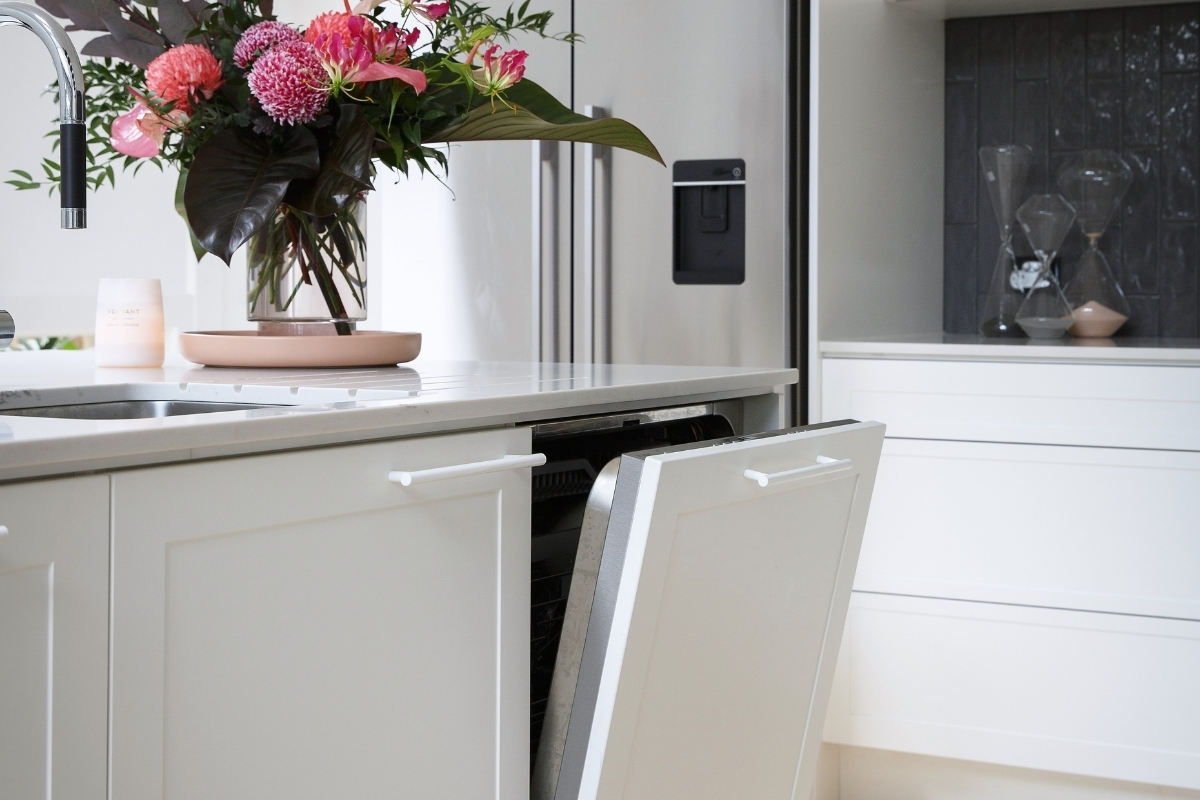 Integrated appliances in a white shaker-style kitchen