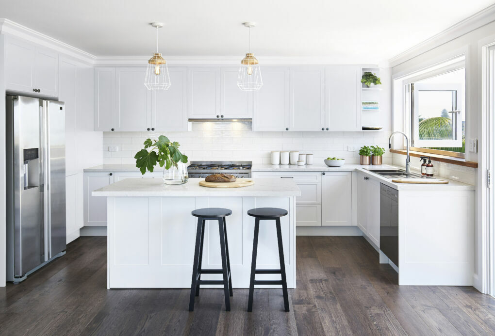 White shaker-style U-shaped kitchen
